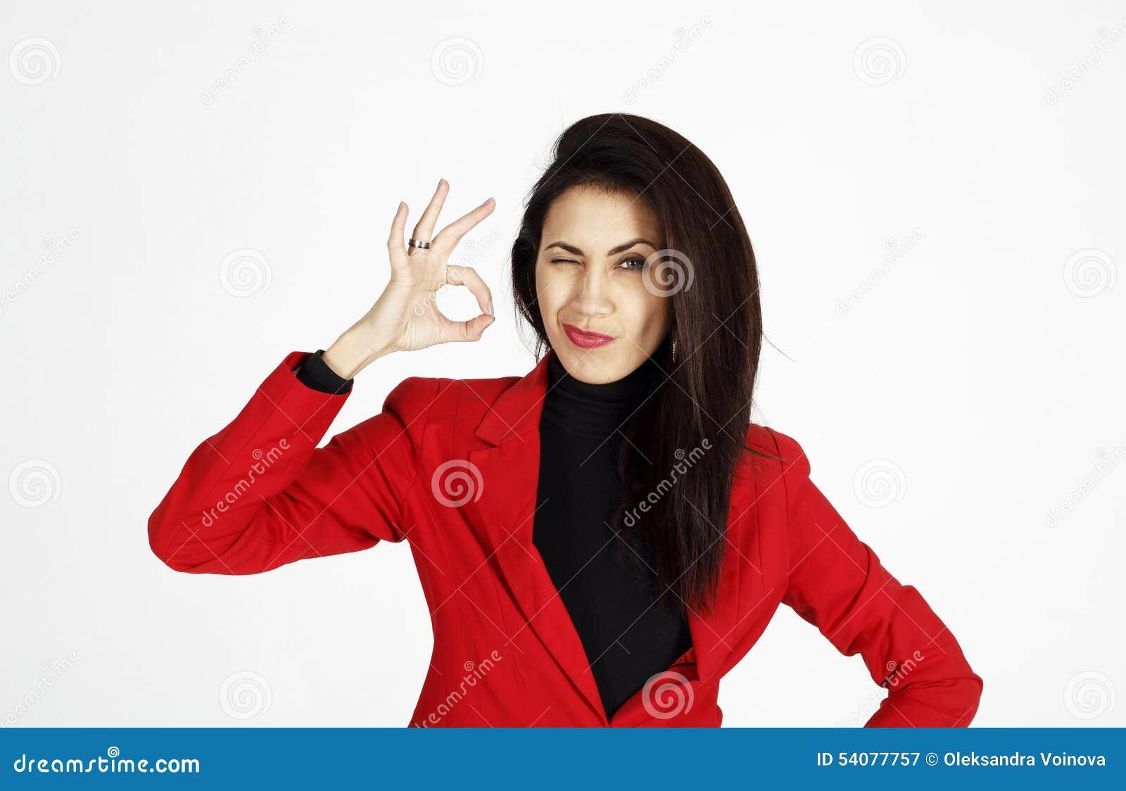 Portret van het jonge mooie bedrijfsvrouw tonen die hand tonen