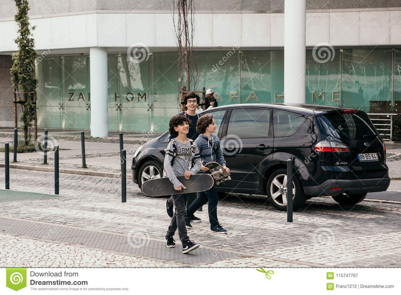 Portugal, Lisbon 29 april 2018: children or kids or teenagers walk down by street with skateboards