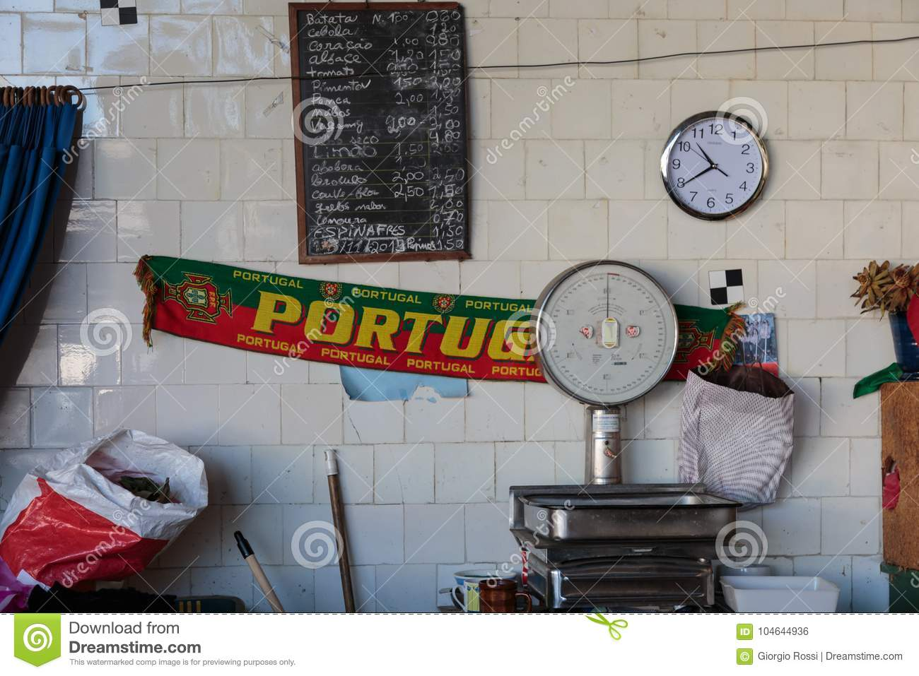 Portugal Scarf, Food Scale, Watch and Price List on White Tile Wall inside Antique Bolhao Market: in Porto, Portugal