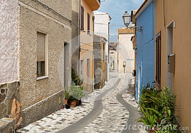 Posada Italy  City pictures : Colored houses in a narrow street in Posada, Sardinia, Italy.