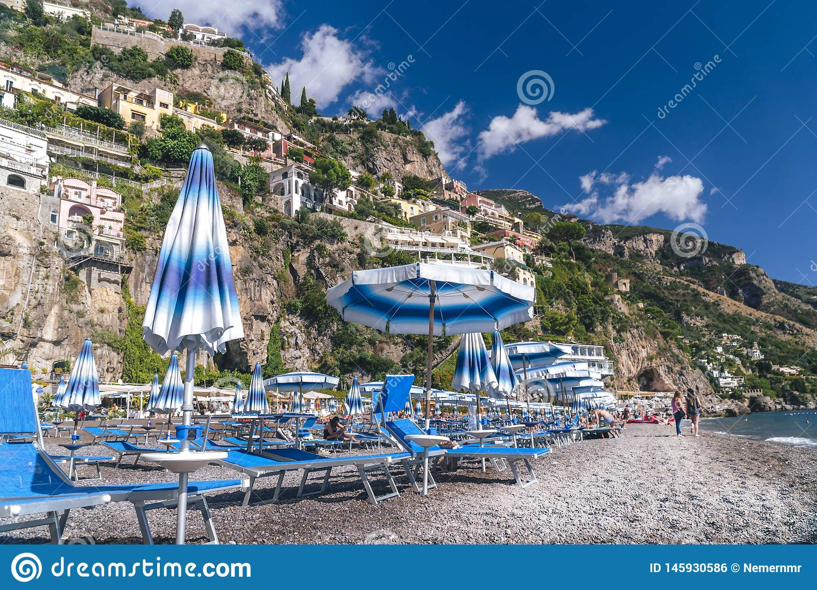 Positano, Italy - Beach with umbrellas, Amalfi coast, vacation concept