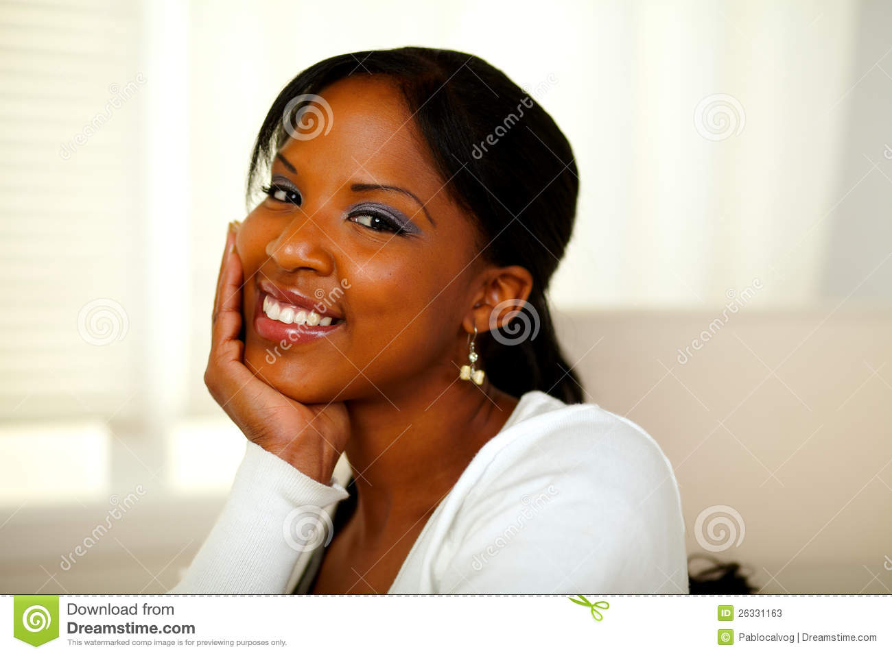 Positive afro-american pretty woman looking at you