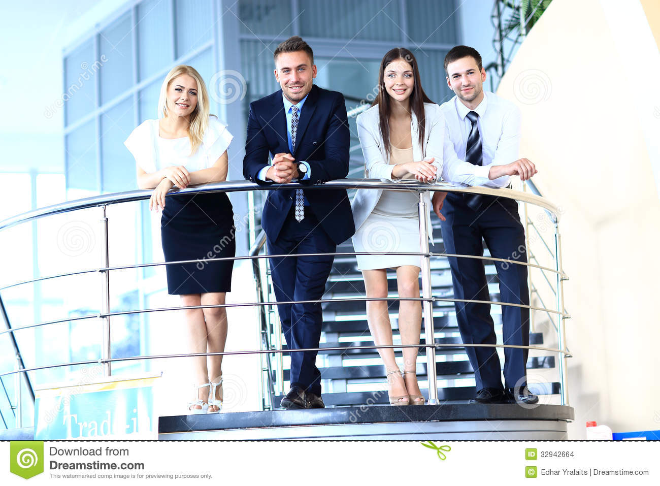 positive business group standing on stairs of modern office business office modern