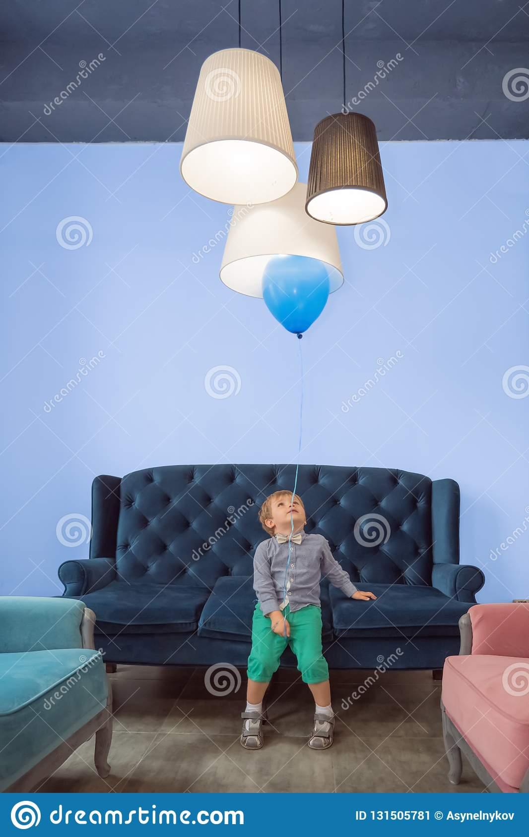 Positive child having fun with balloon. Children celebration background.