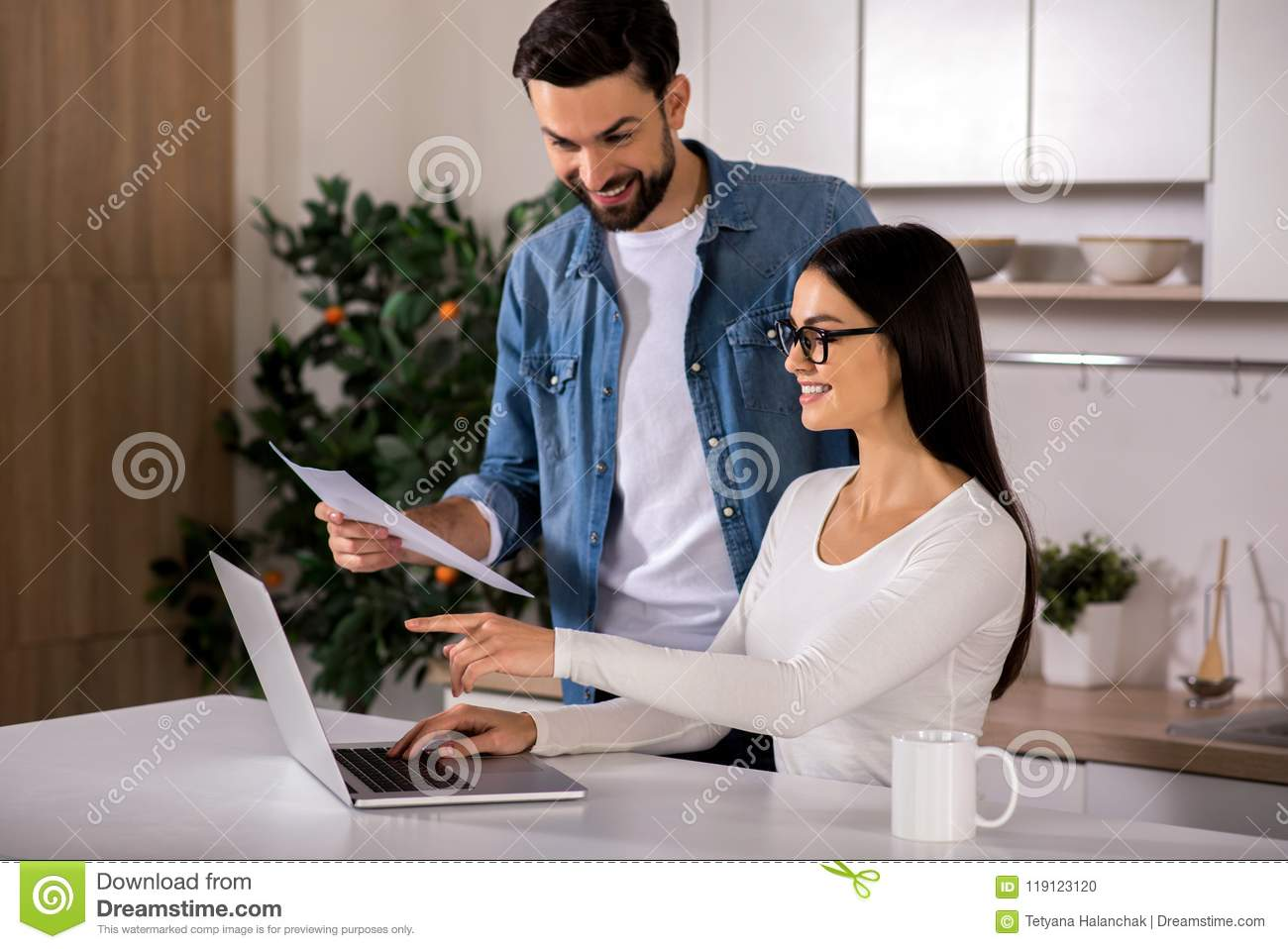 Positive couple of entrepreneurs sitting at home