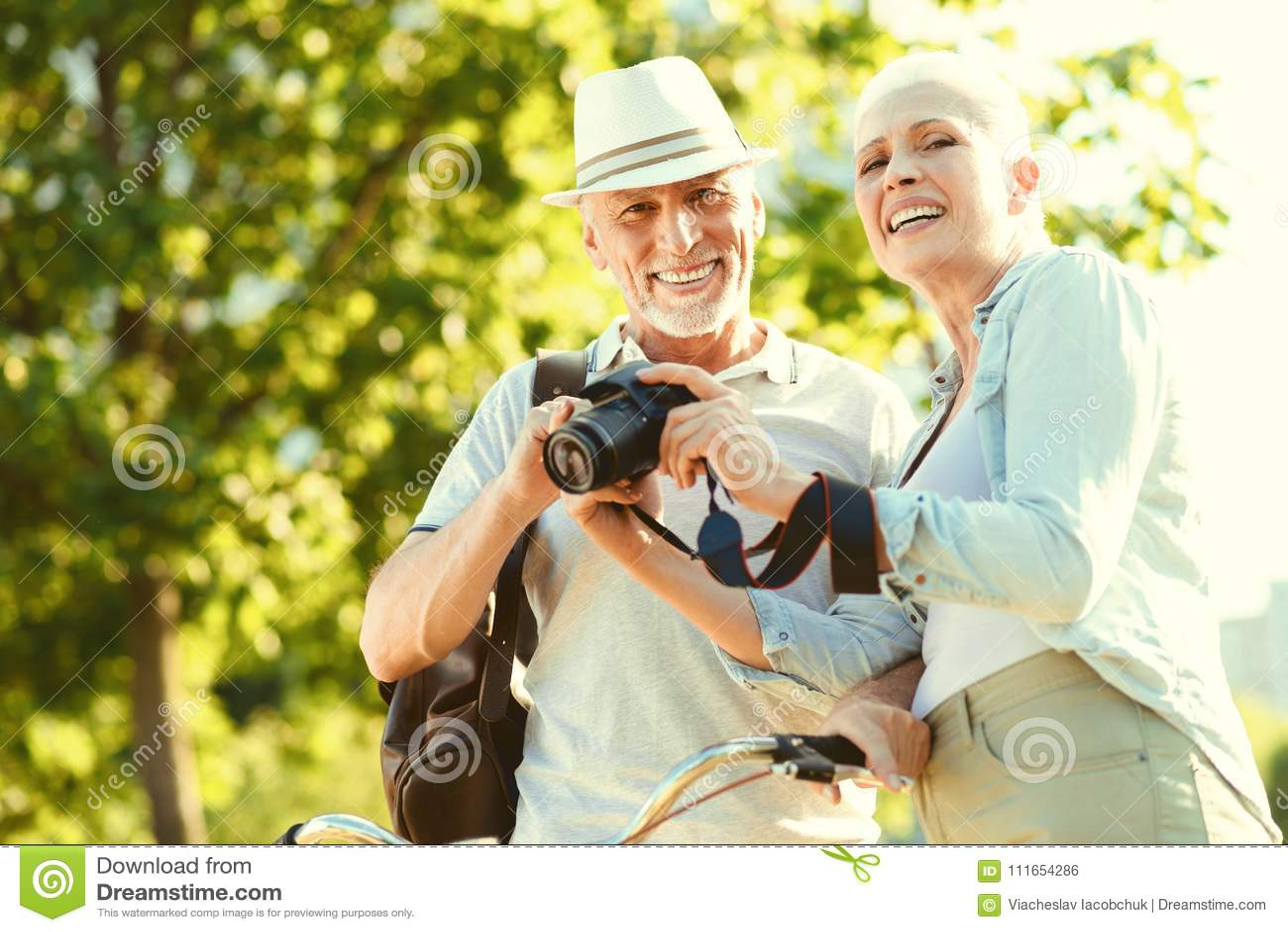 Positive elderly couple having a walk