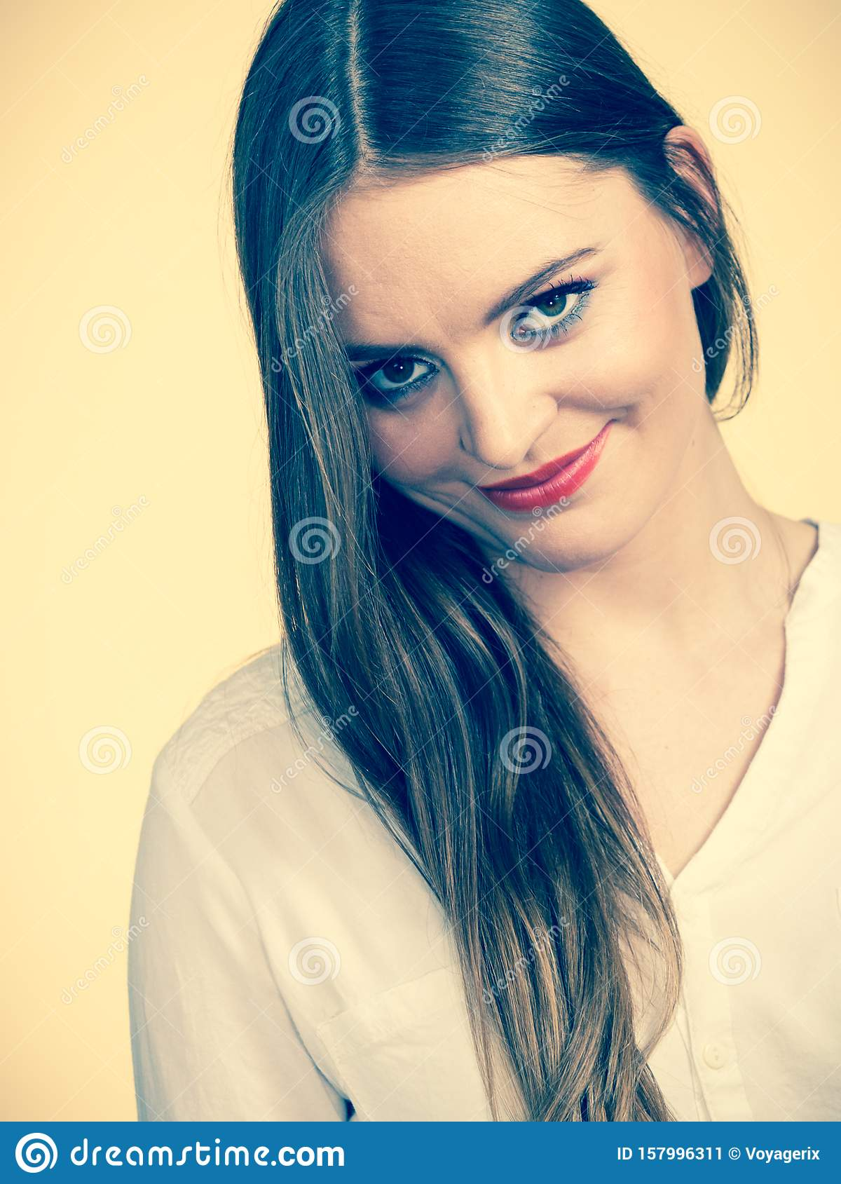 Smiling attractive woman with full makeup