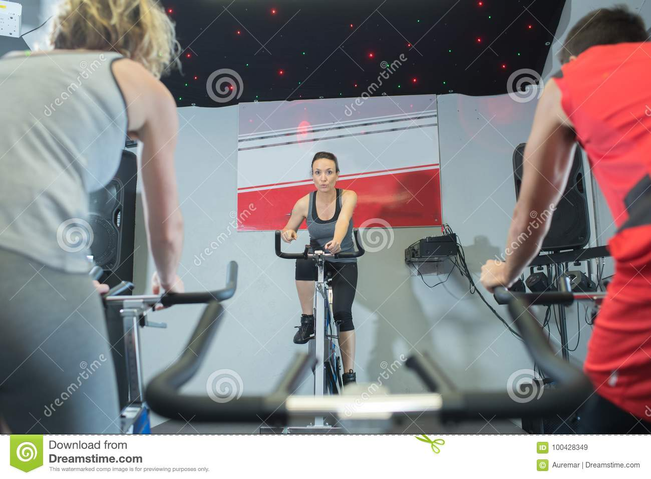 Positive Females Different Age Training On Exercise Bikes Stock
