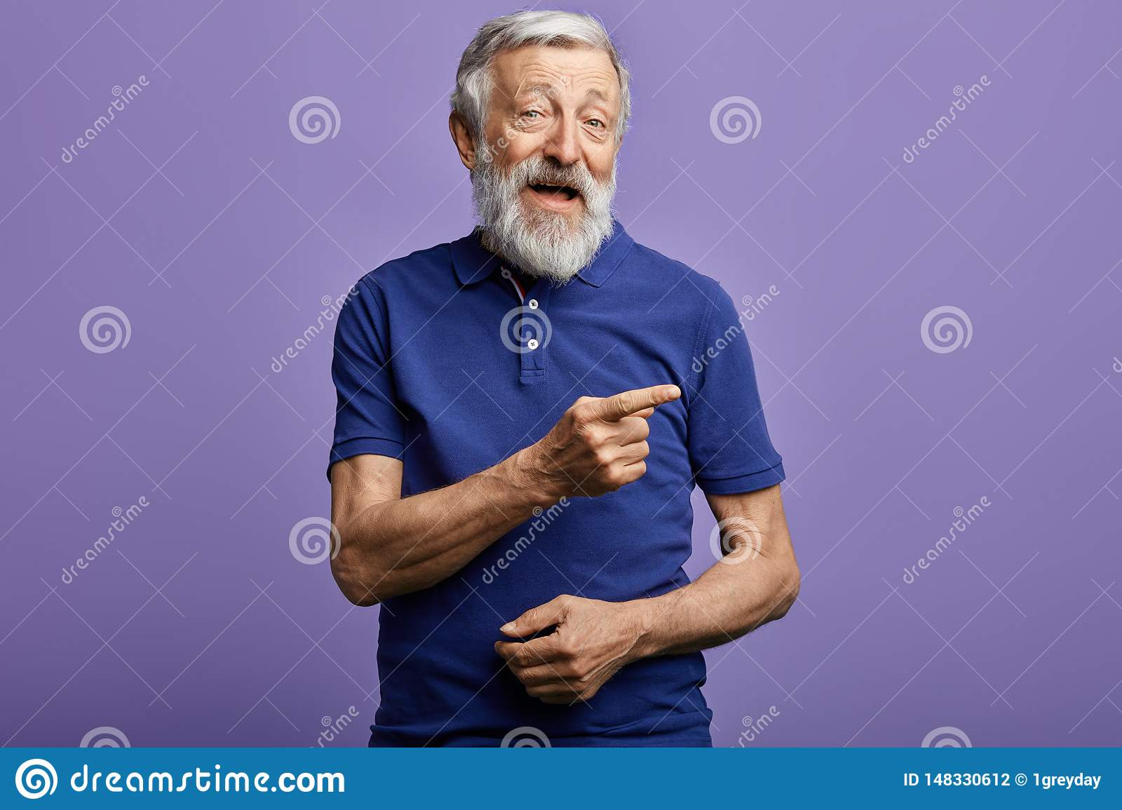 Positive man pointing with hand and finger to the side