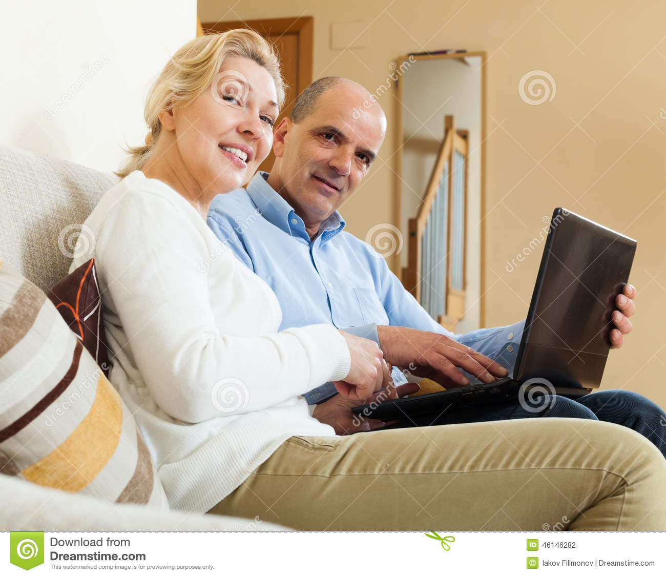 Positive Mature Couple With Laptop Stock Photo - Image