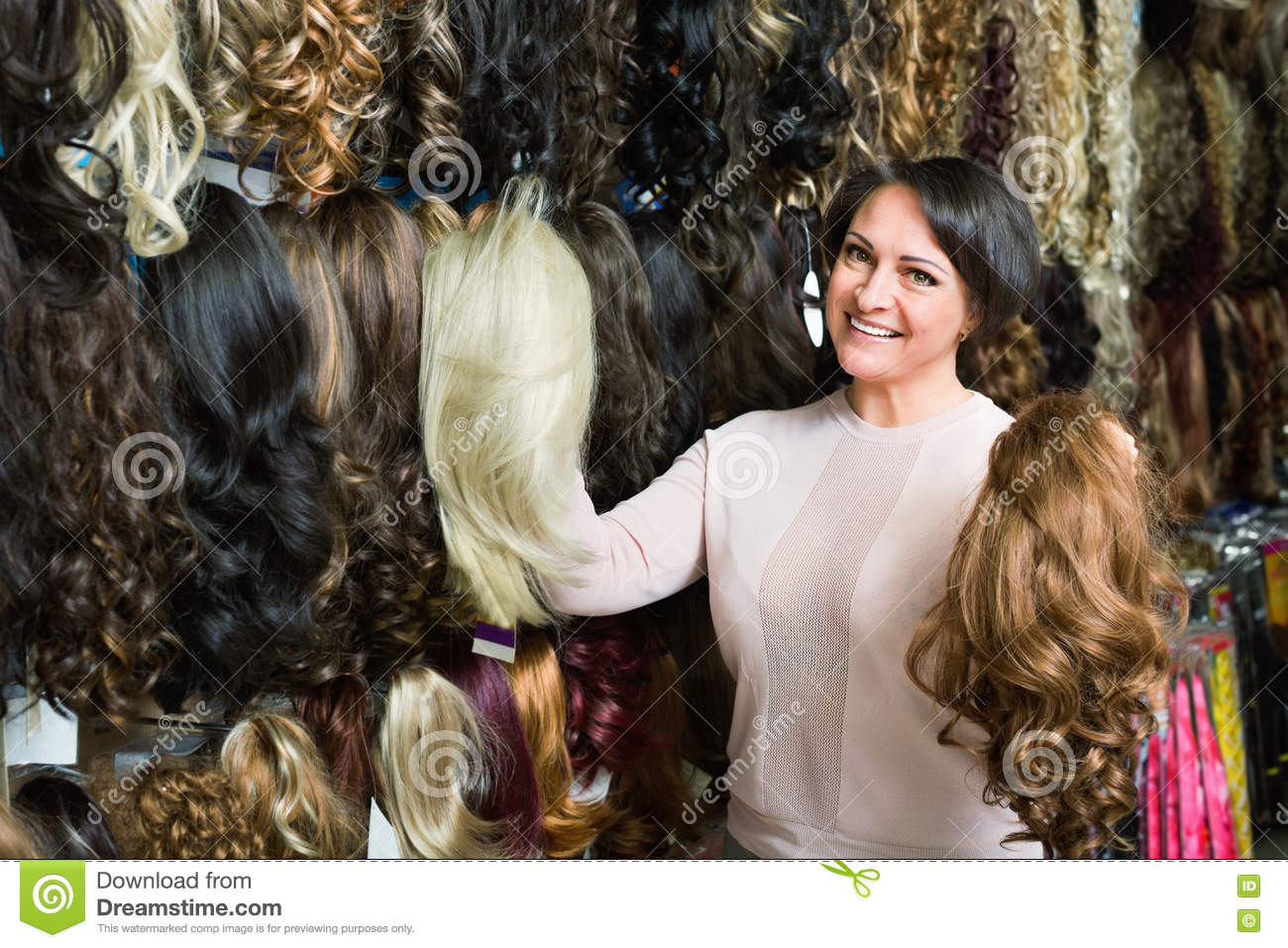 Positive Middle Aged Woman Purchasing Hair Extension Stock Photo