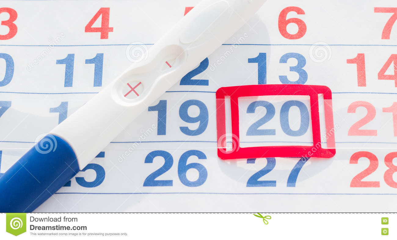 Positive pregnancy test with calendar top view