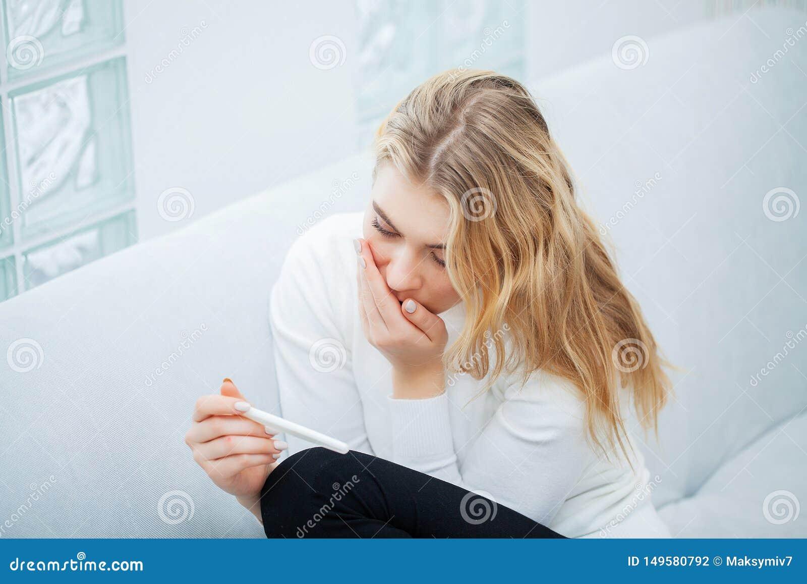 Positive Pregnancy Test. Portrait Of Desperate Young Woman ...