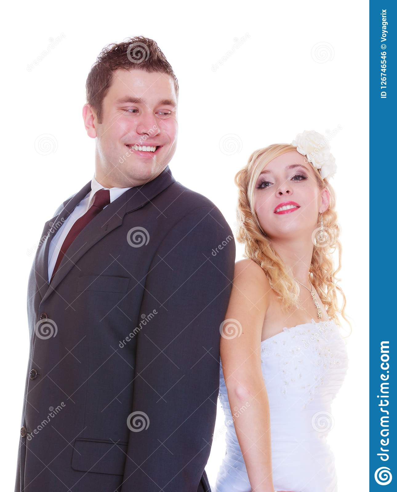 Happy groom and bride posing for marriage photo