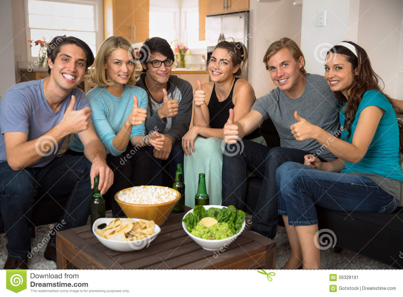 Positive Thumbs Up Group Of Friends Gathered At Home