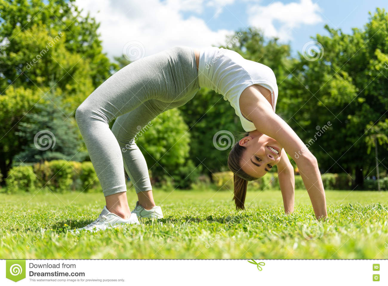 Positive woman standing in the back bend position