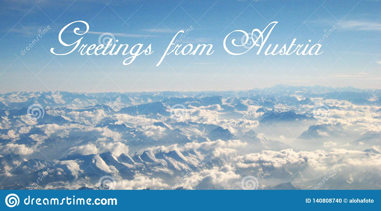 Postcard with a beautifully panorama view from a flight over the clouds and snowy Alps on a sunny day
