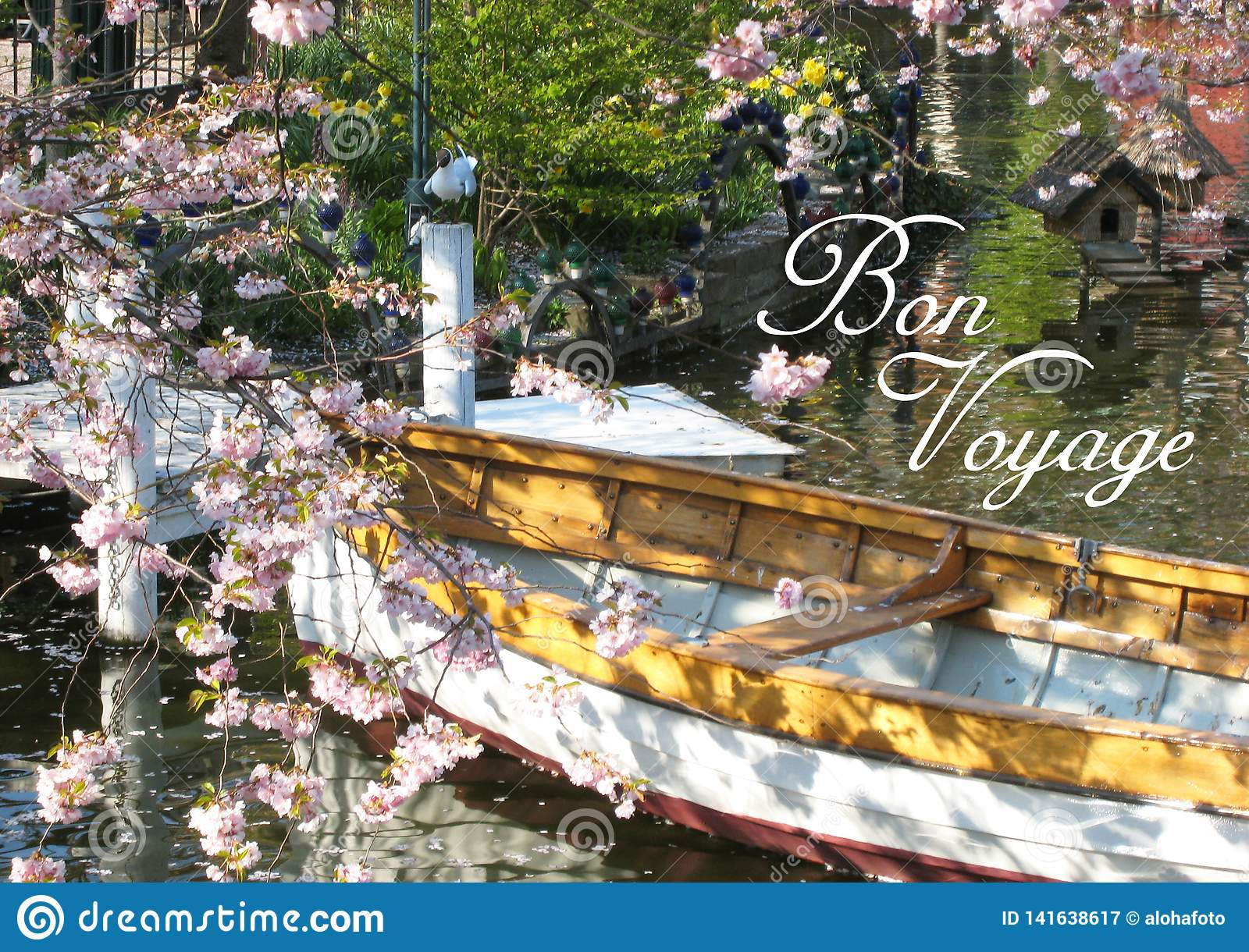 Postcard with a beautifully view of a wooden boat in Copenhagen in Denmark surrounded by a sea of flowers in a small lake
