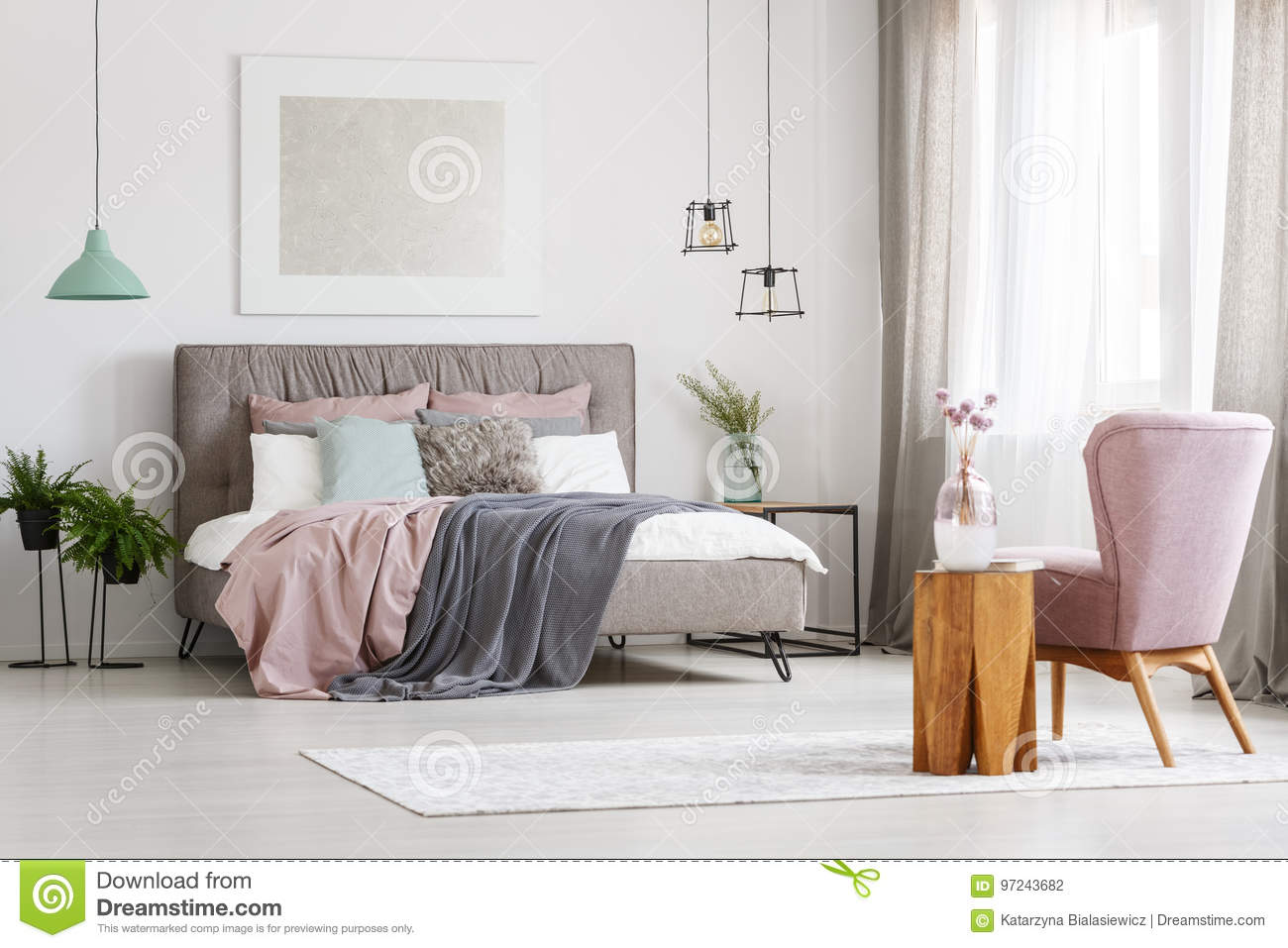 Poster above bed stock photo. Image of blankets, lampshade - 97243682