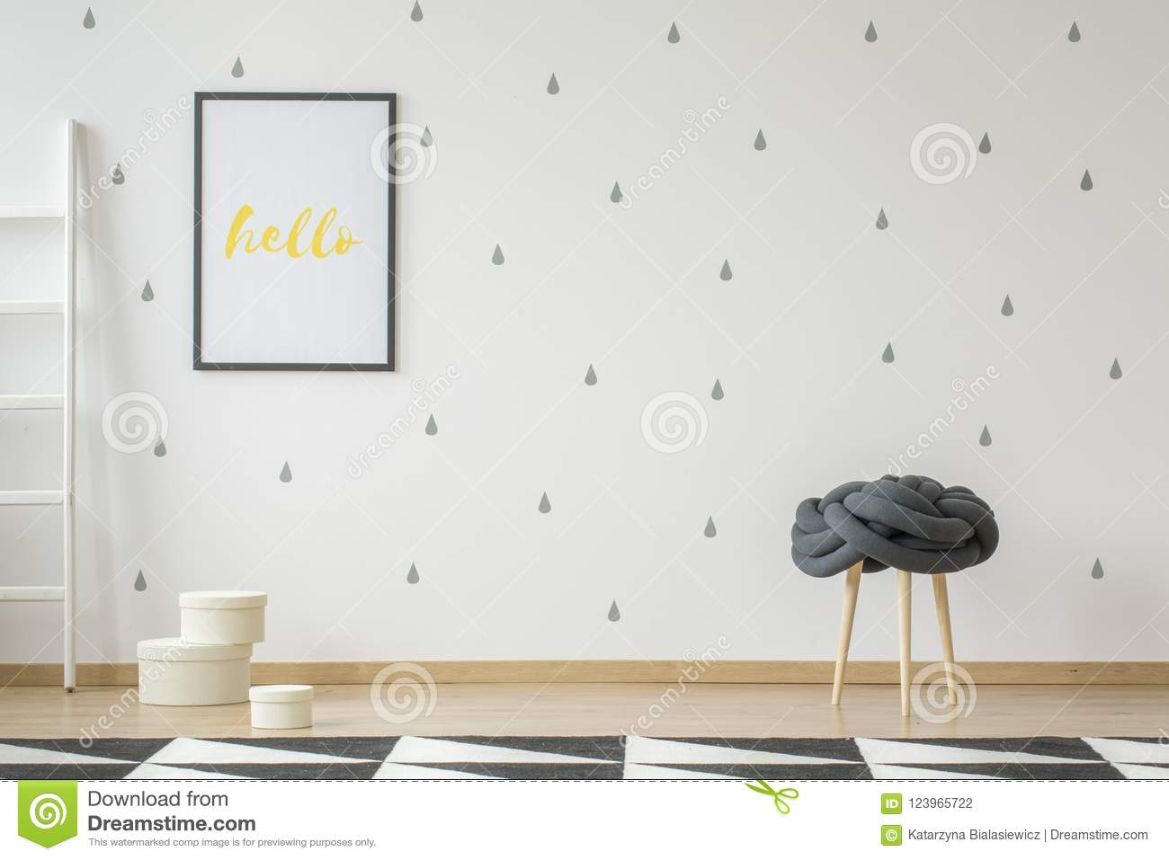 Poster on wallpaper in teenager`s room interior with stool and g