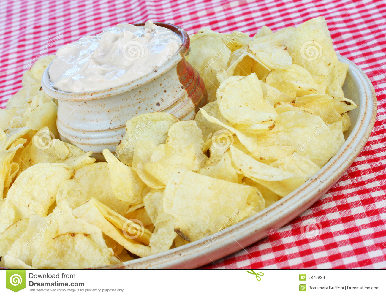 Potato Chips and Onion Dip in a tilted composition.