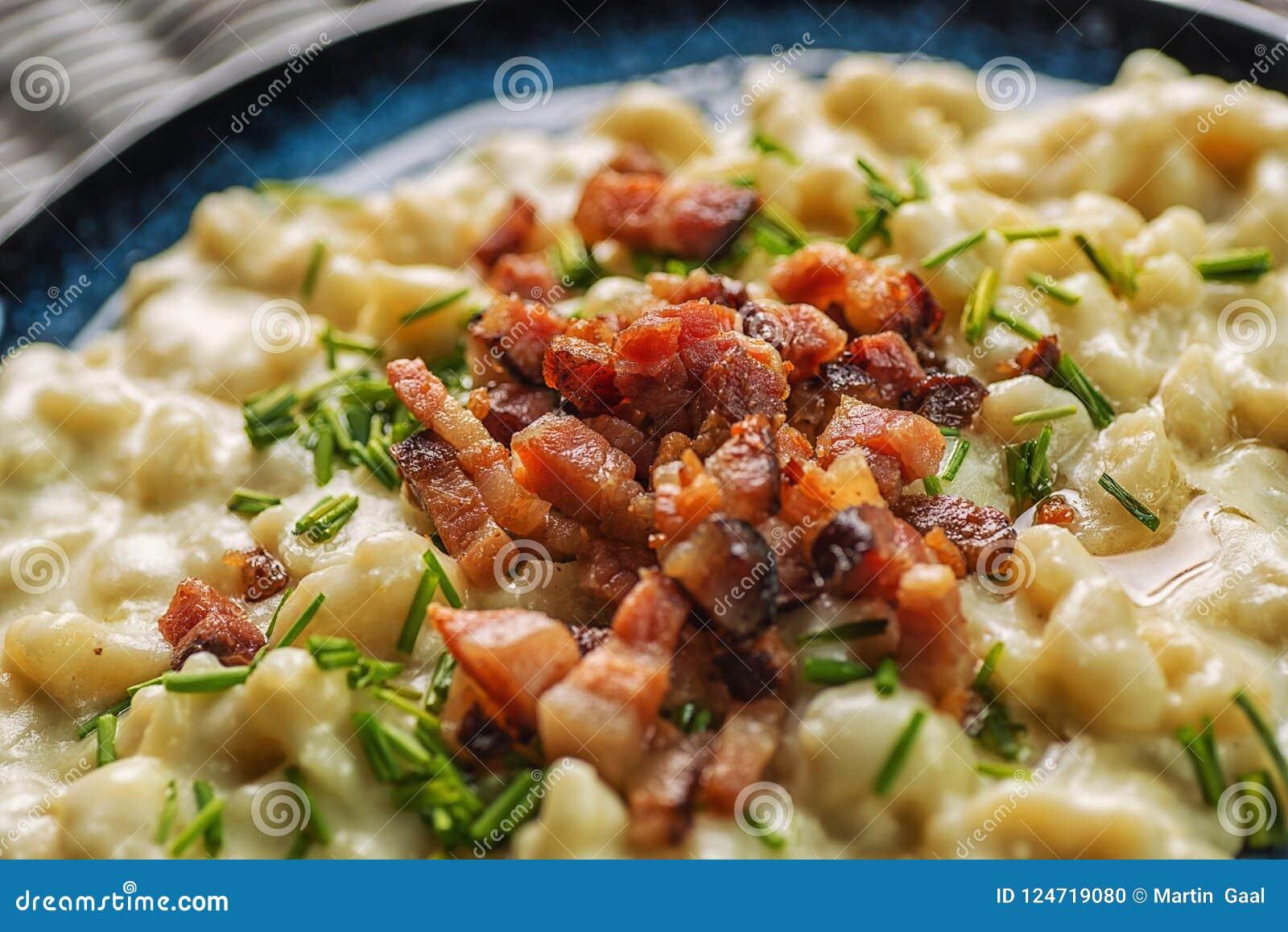 Potato dumplings with sheep cheese and bacon, traditional slovakian food, slovak gastronomy