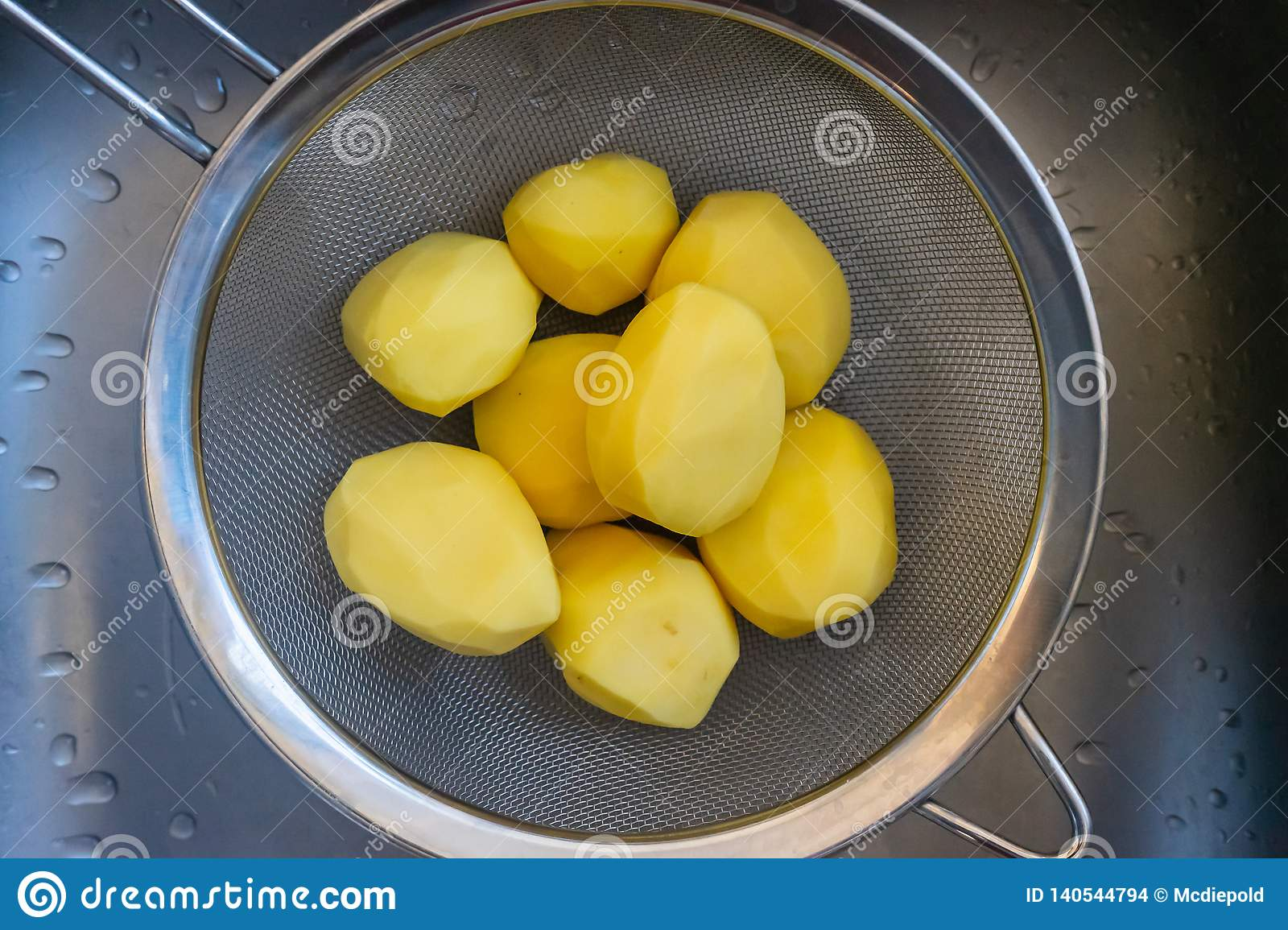 Potatoes peeled in a sieve
