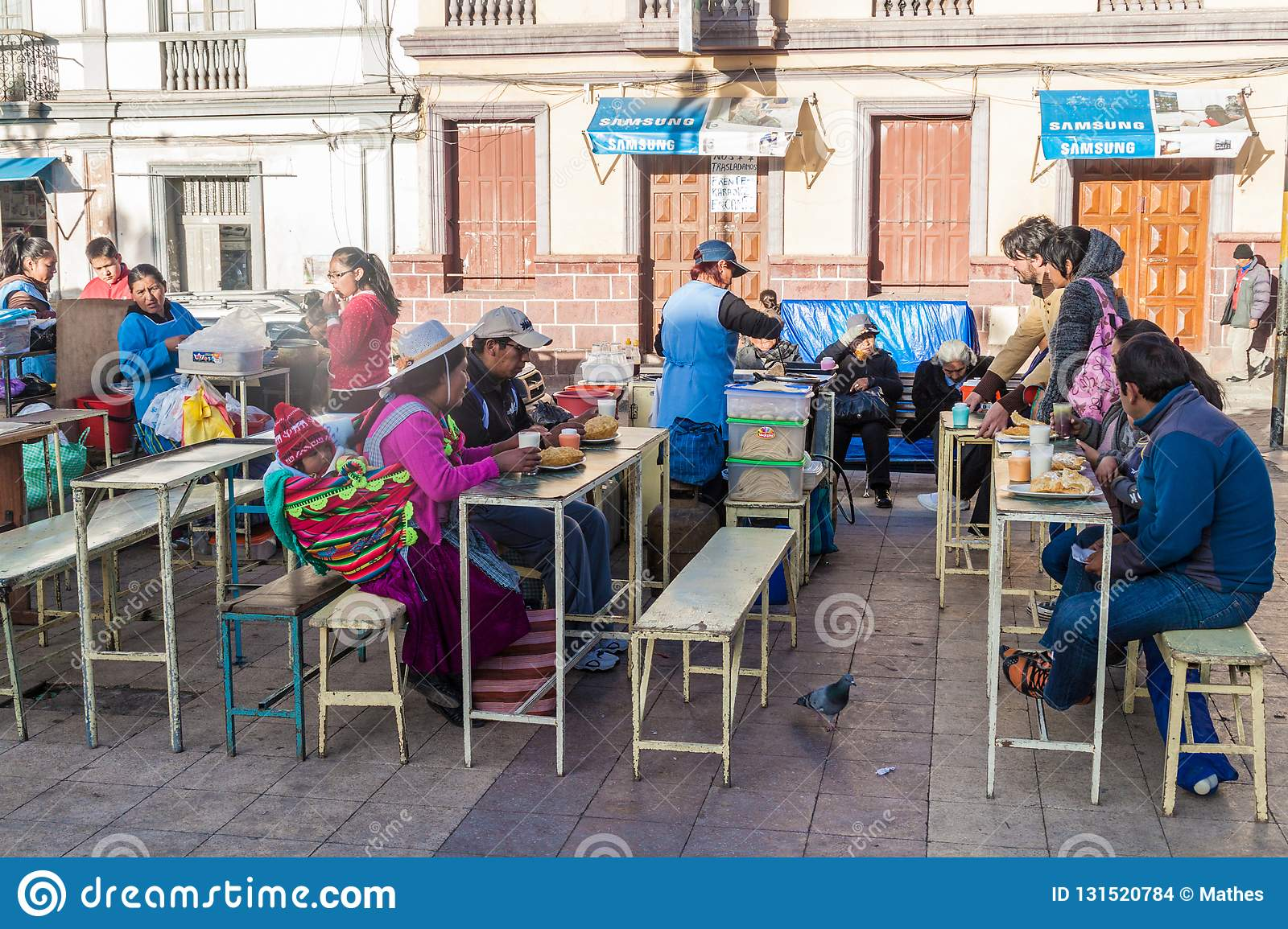 POTOSI, BOLIVIA - APRIL 19, 2015: Local people eating on a market in Potos