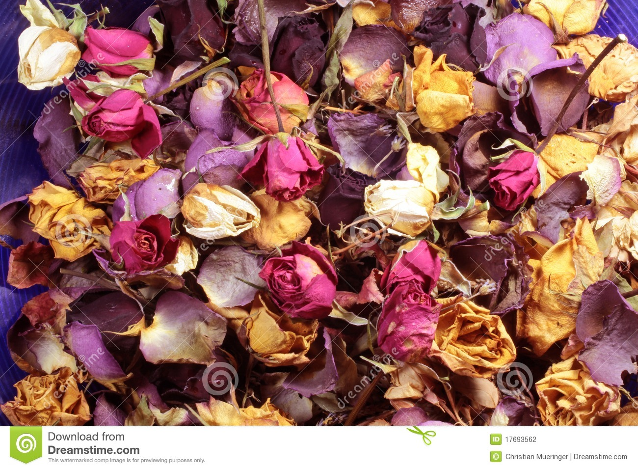 Close-up of a potpourri of colorful dried roses.