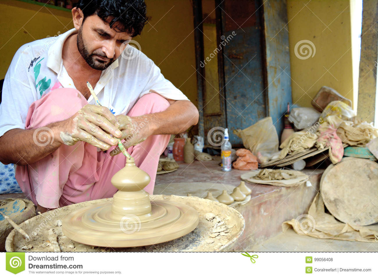 India Local Potter making pot on wheel