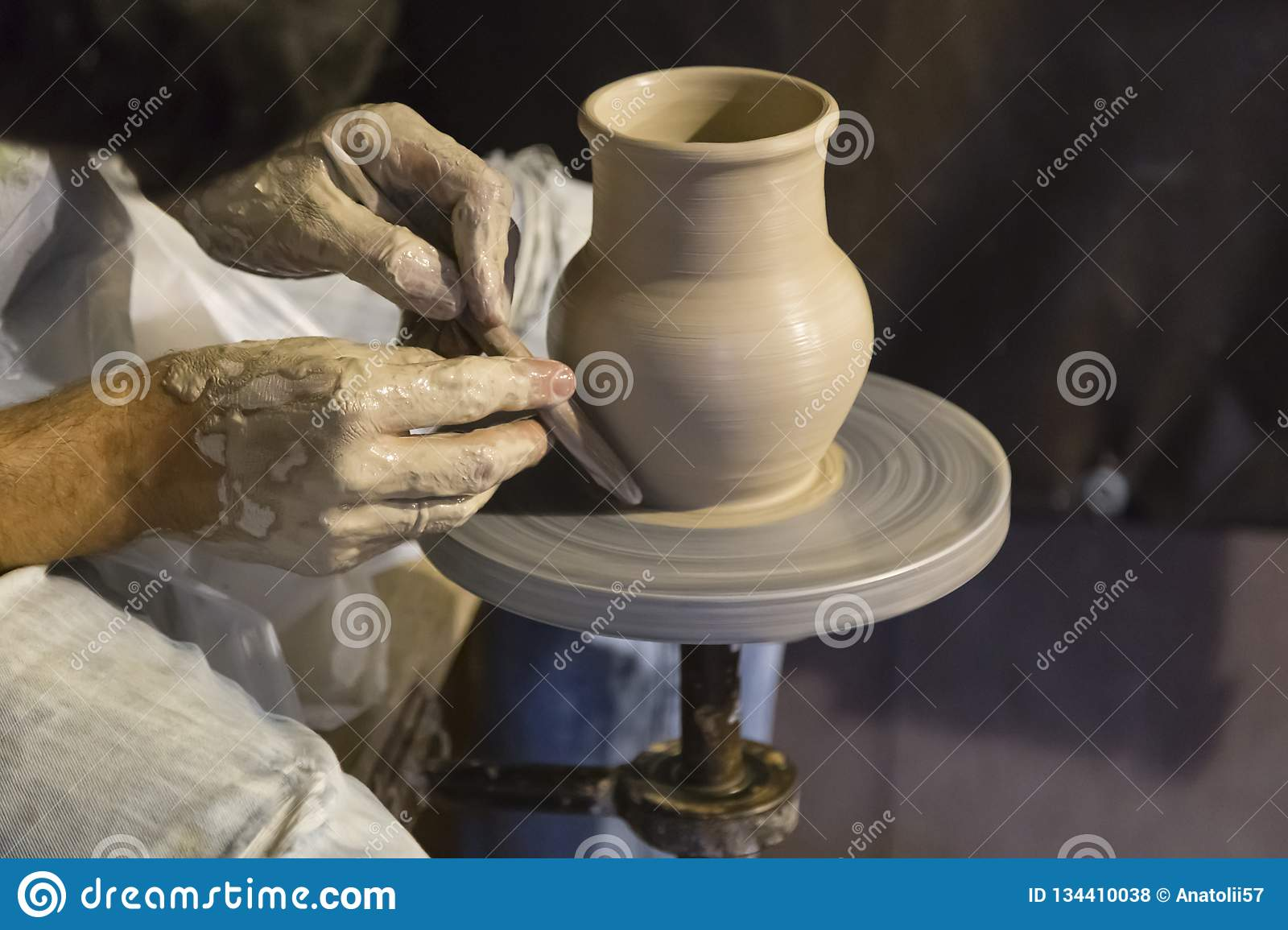 The potter works on the potter`s wheel