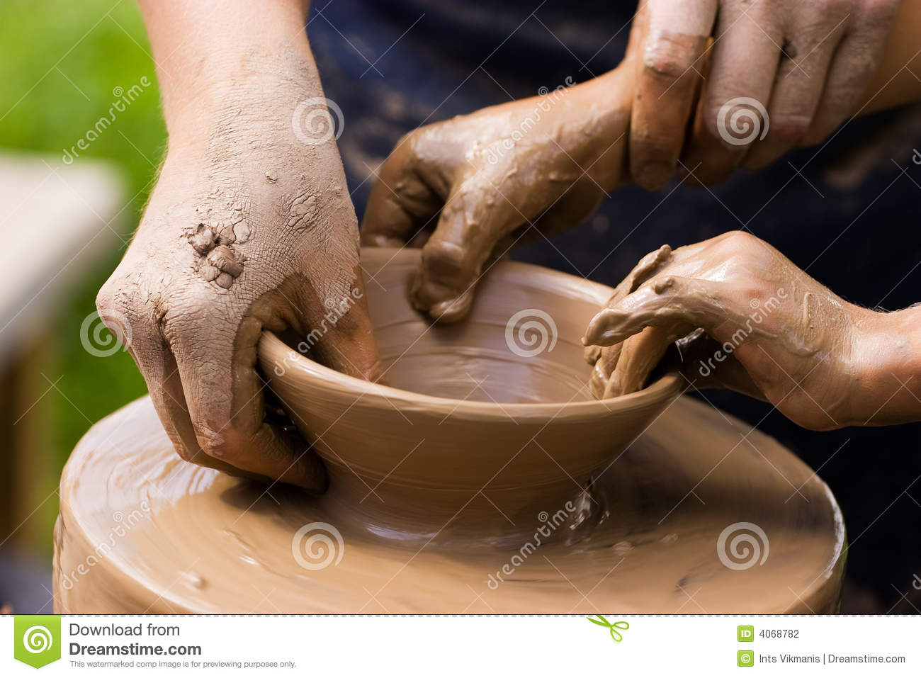 Potters and child hands