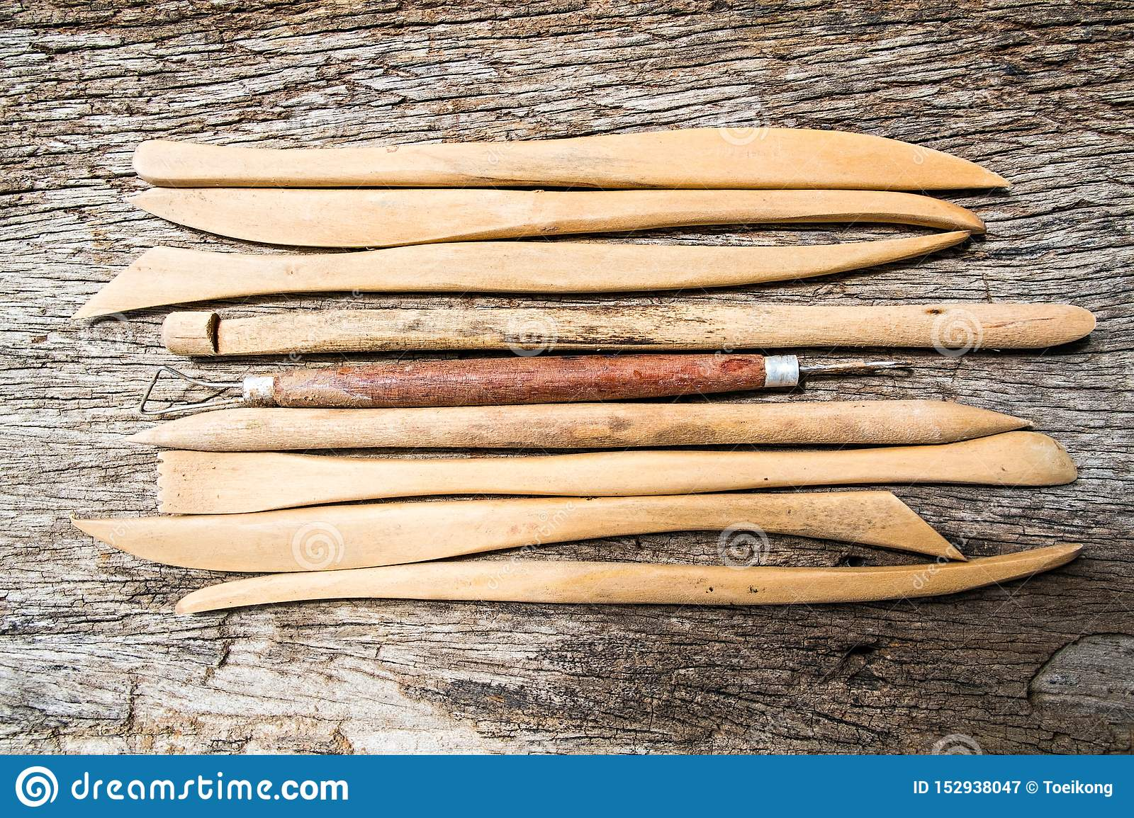Pottery tools on wood background