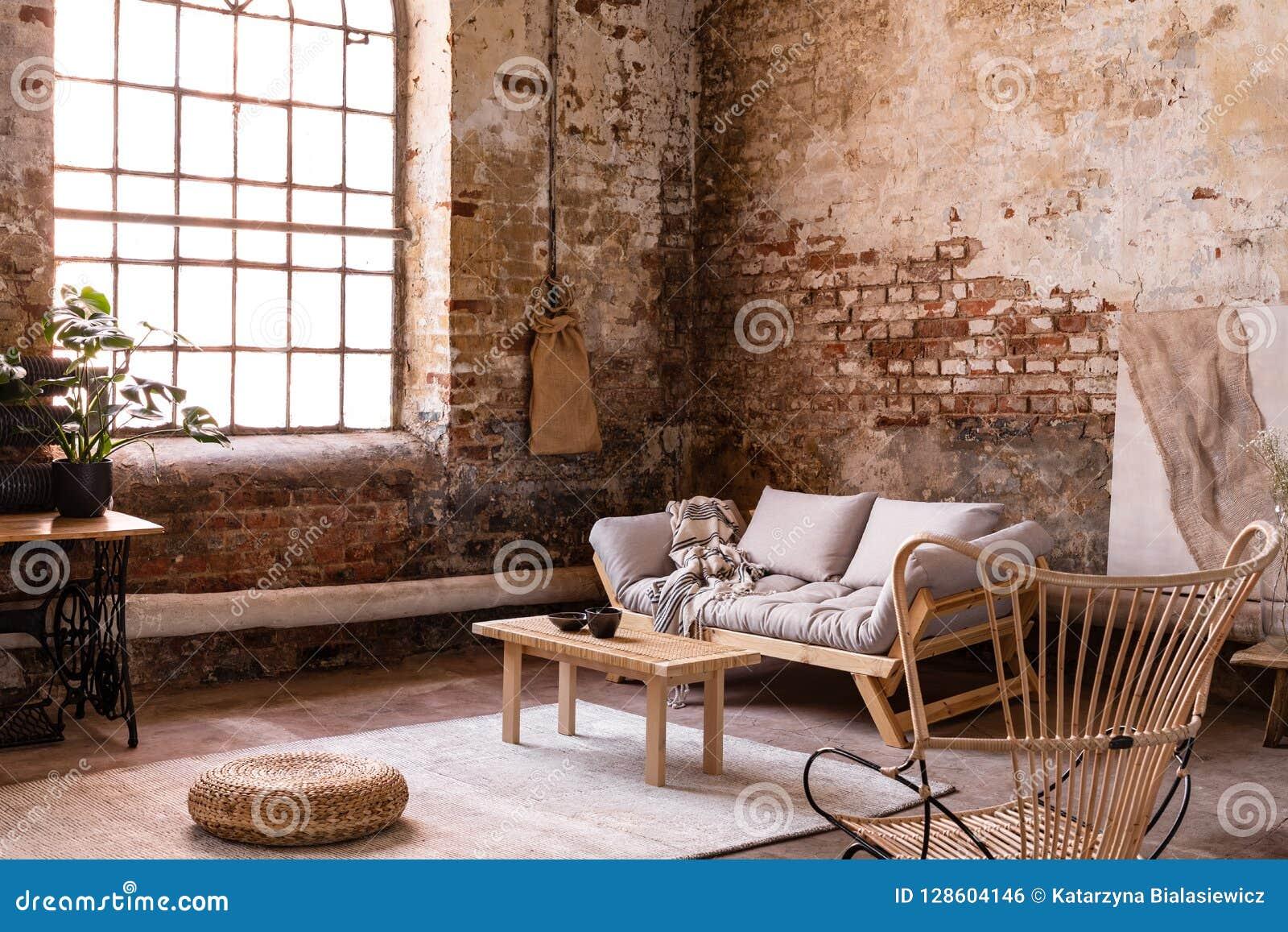 Pouf and wooden table on carpet near window in wabi sabi interior with sofa and armchair stock - Wabi sabi interior design ...