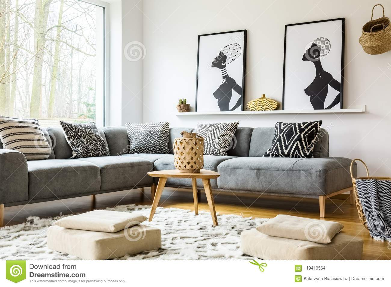Poufs On Carpet In Bright African Living Room Interior With Grey