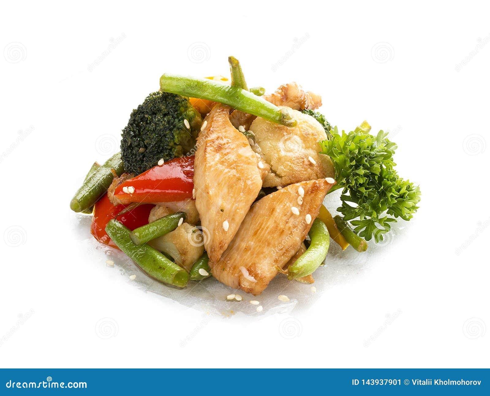 Poulet, frit dans le WOK avec des légumes en sauce de soja Déjeuner asiatique