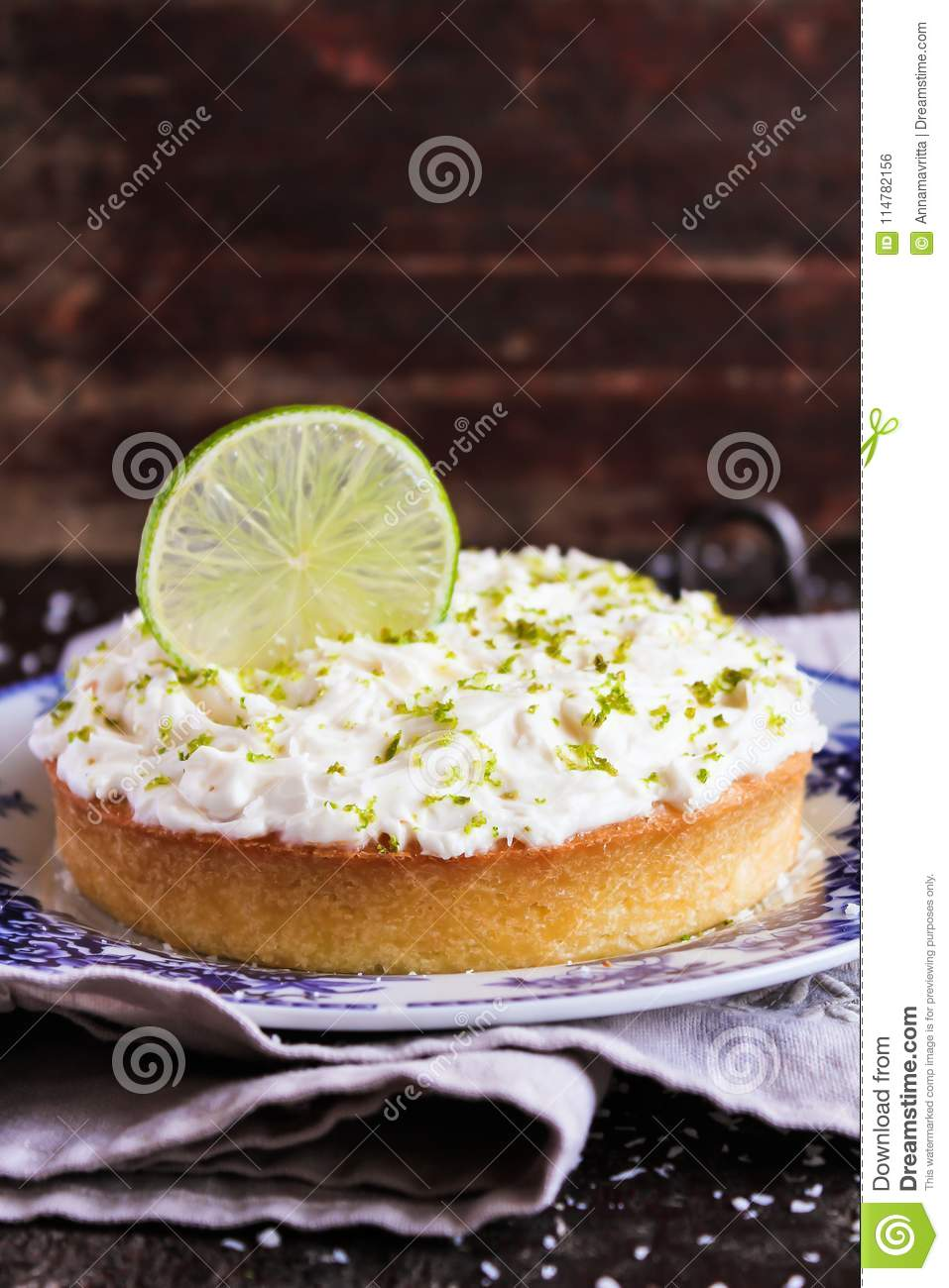 Pound cake with lemon, lime and freshly shredded coconut with cream cheese frosting, selective focus. Copy space.