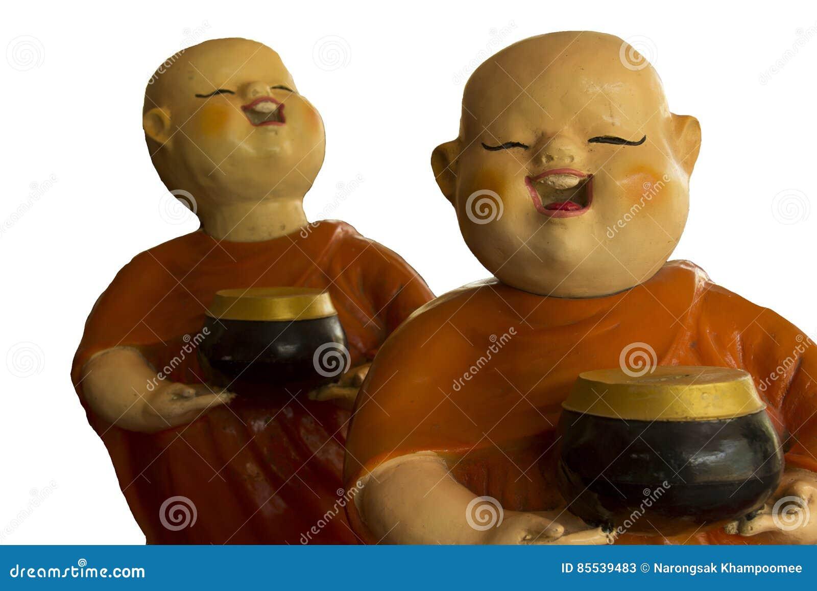 Poupée bouddhiste de novice d isolement sur le fond blanc