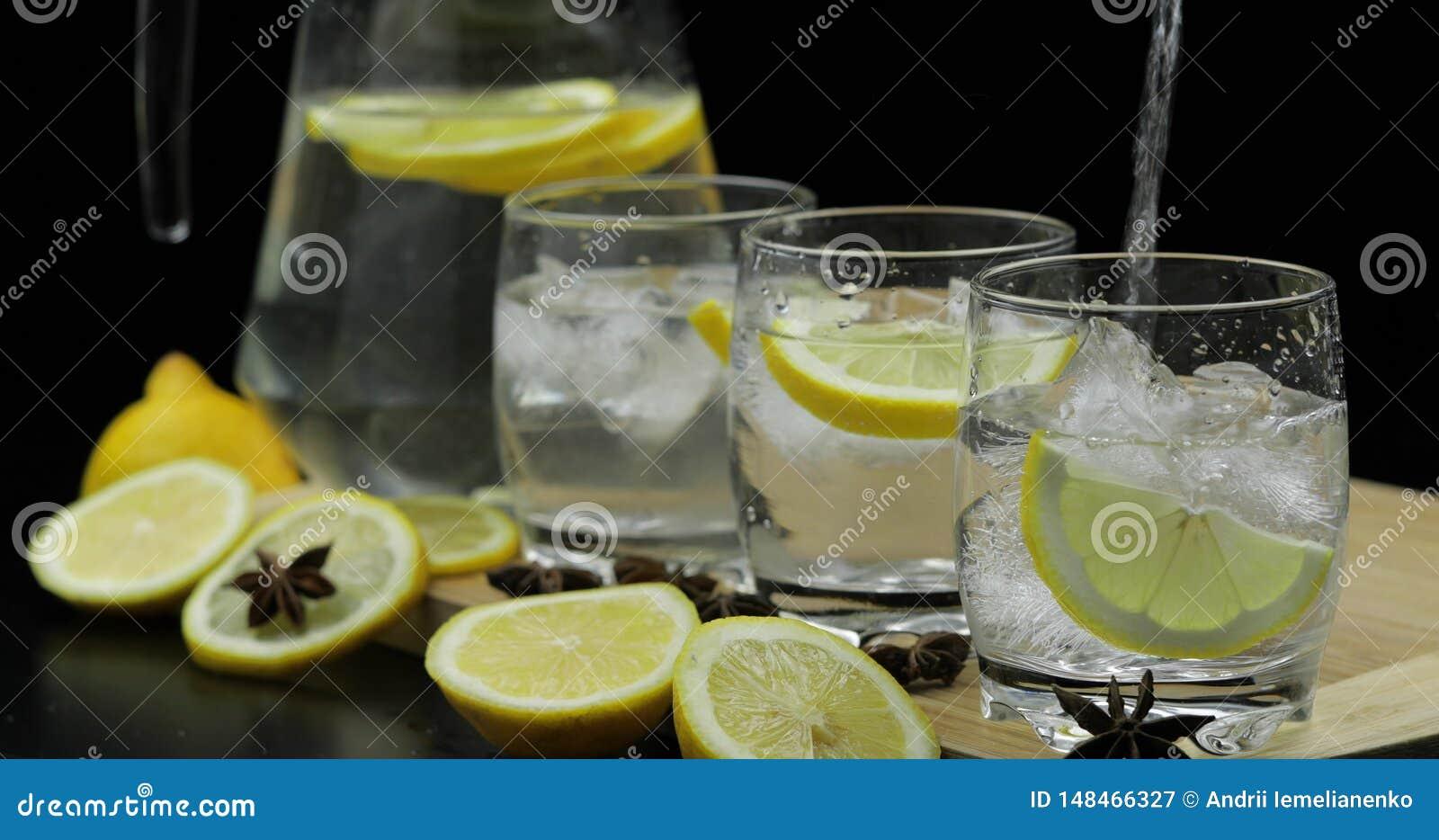 Pour lemon juice into glass with ice and lemon slices. Lemon alcoholic cocktail