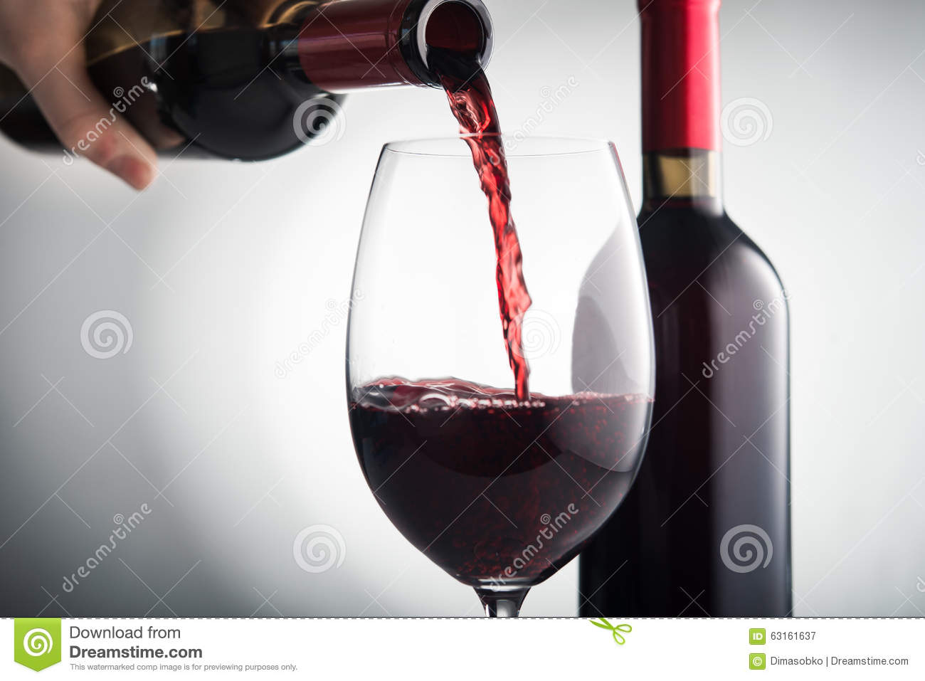 Pour red wine into glass
