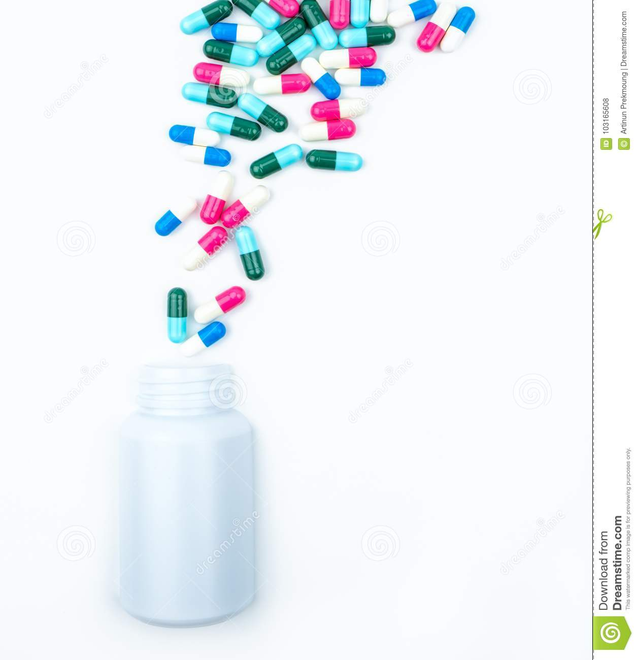 Pouring antibiotics capsule pills into plastic bottle isolated on white background with copy space. Drug storage, antibiotic drug
