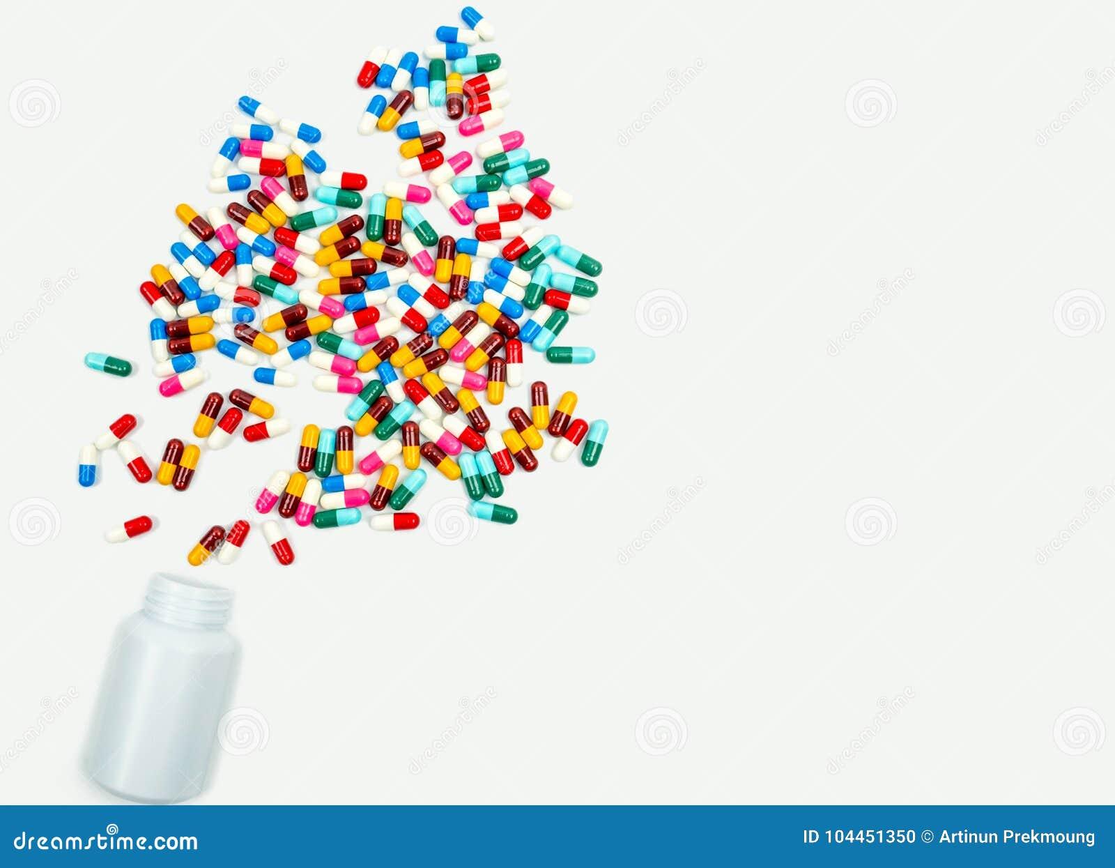 Pouring antibiotics capsule pills into plastic bottle