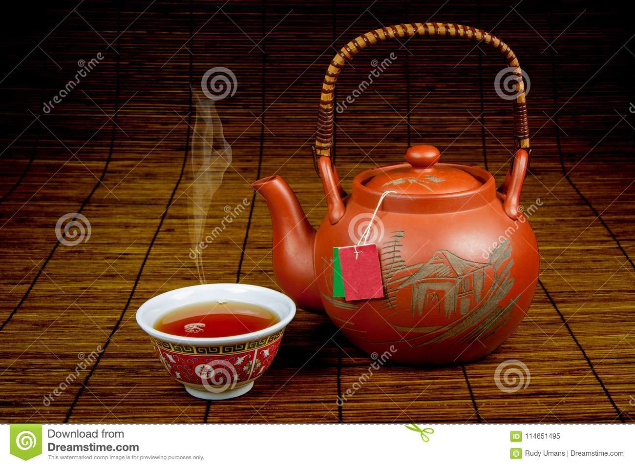 Pouring Chinese tea in a cup-1