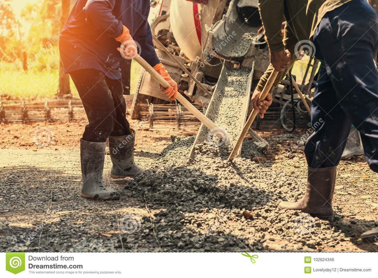 pouring concrete with worker mix cement at construction