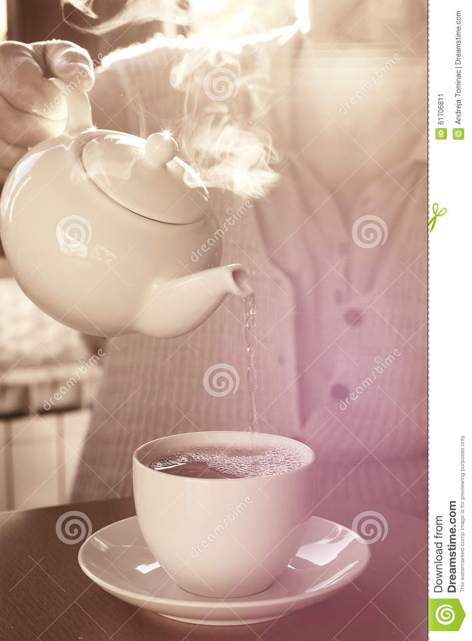 Pouring The Cup Of Tea