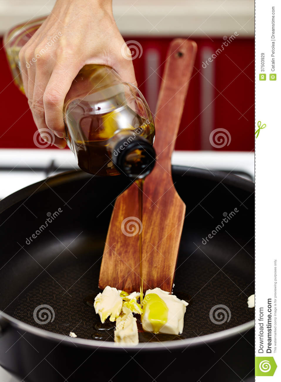 Pouring olive oil over melting butter
