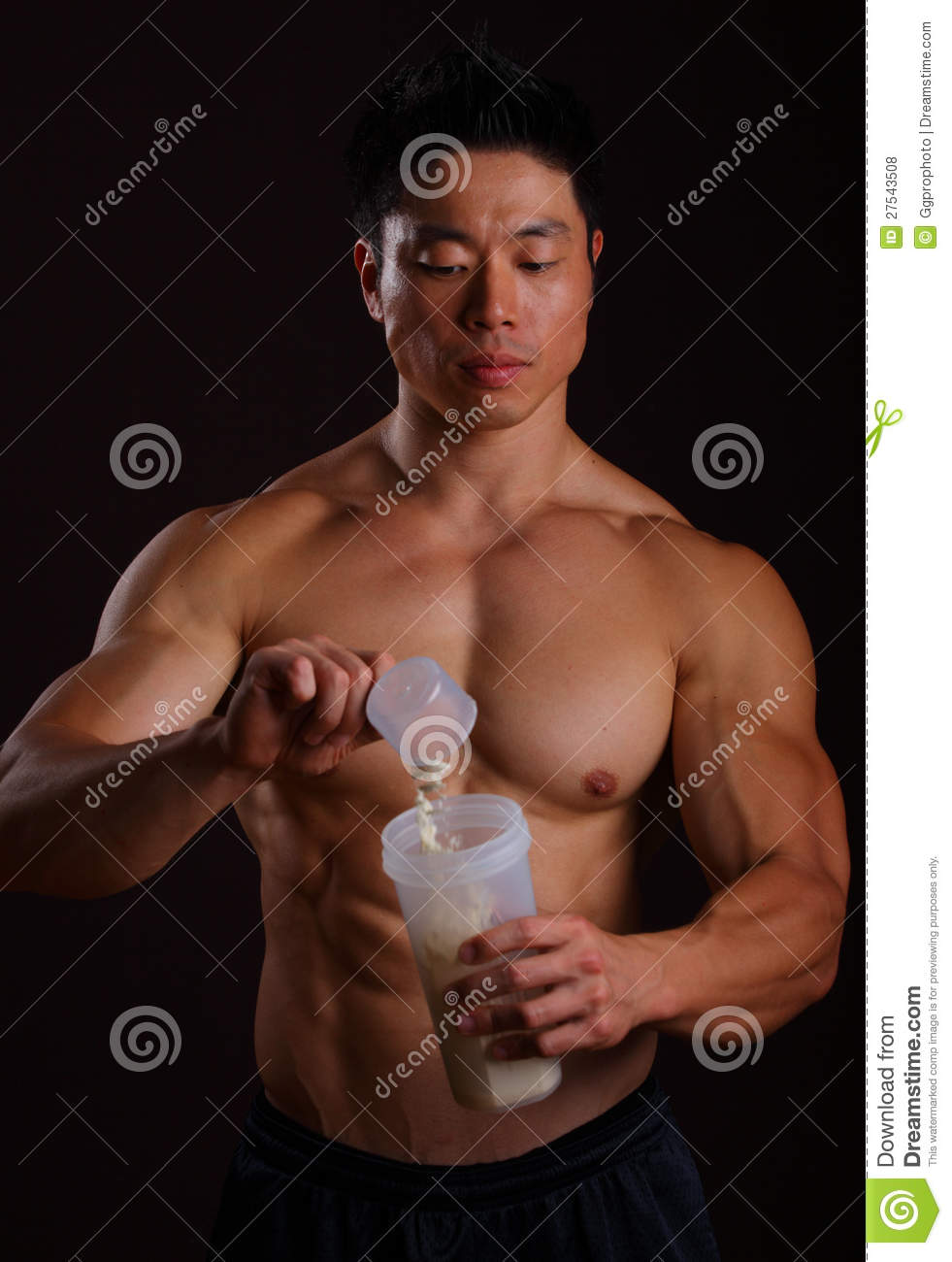Pouring a scoop of protein shake