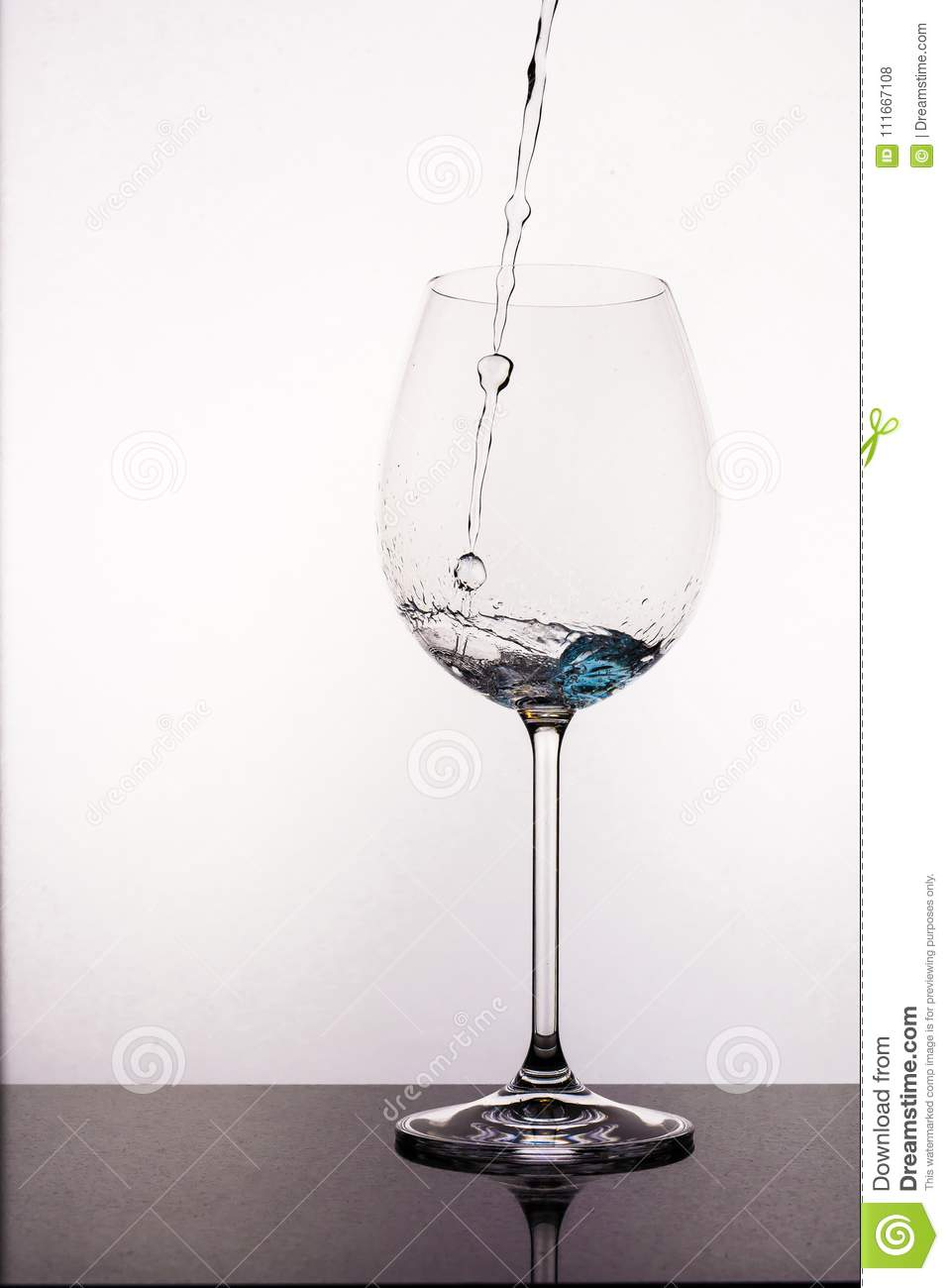 Pouring Water To Wine Glass Stock Photo Image Of Elegant