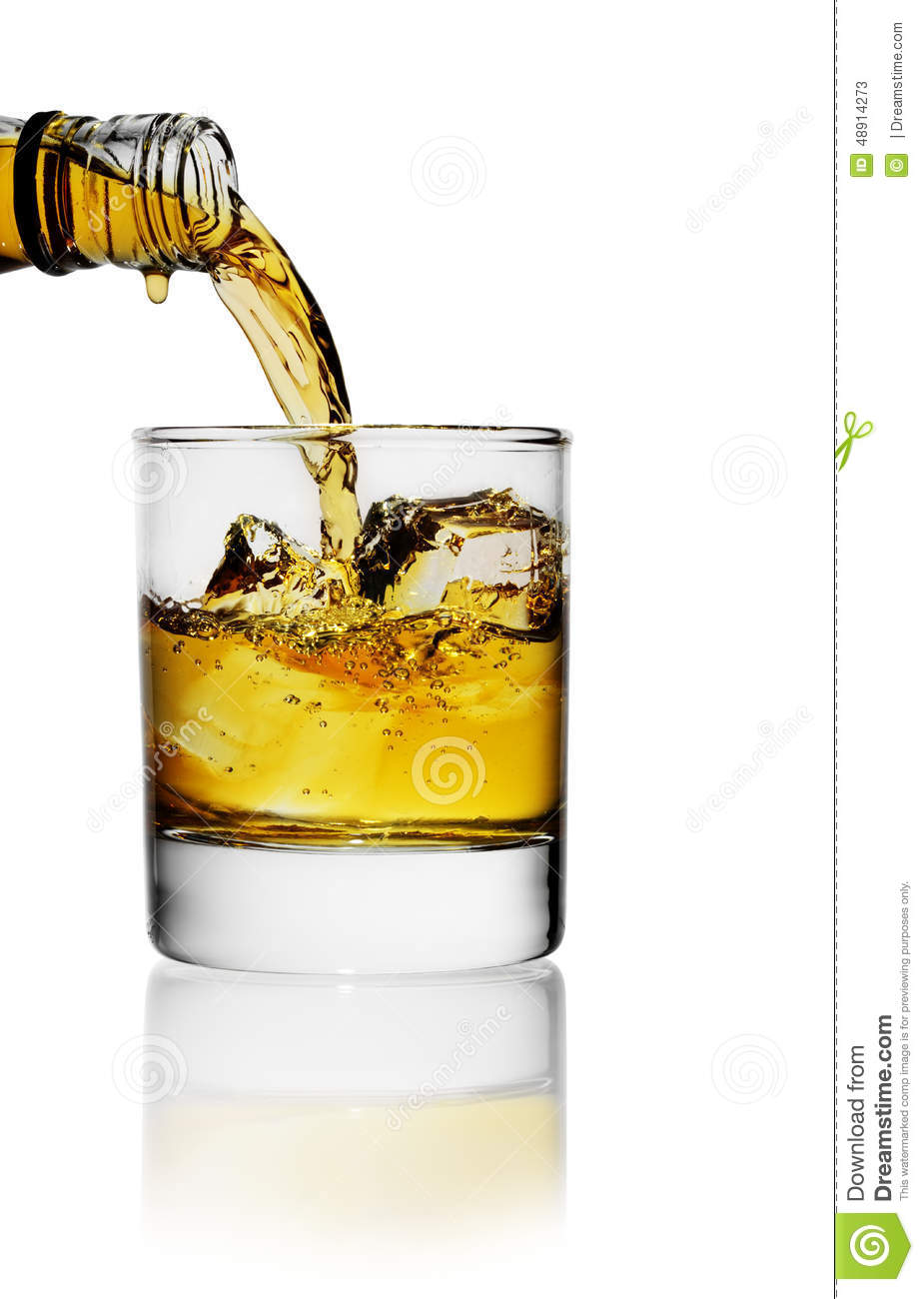 Pouring whiskey in glass stock image. Image of orange ...