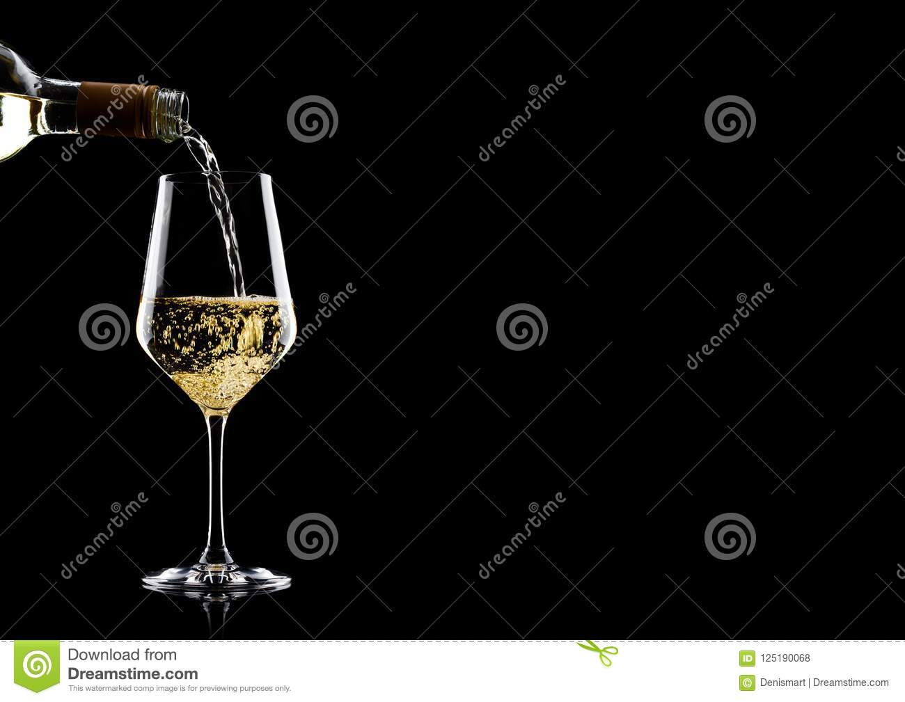 Pouring white wine from bottle to glass on black with space for your text